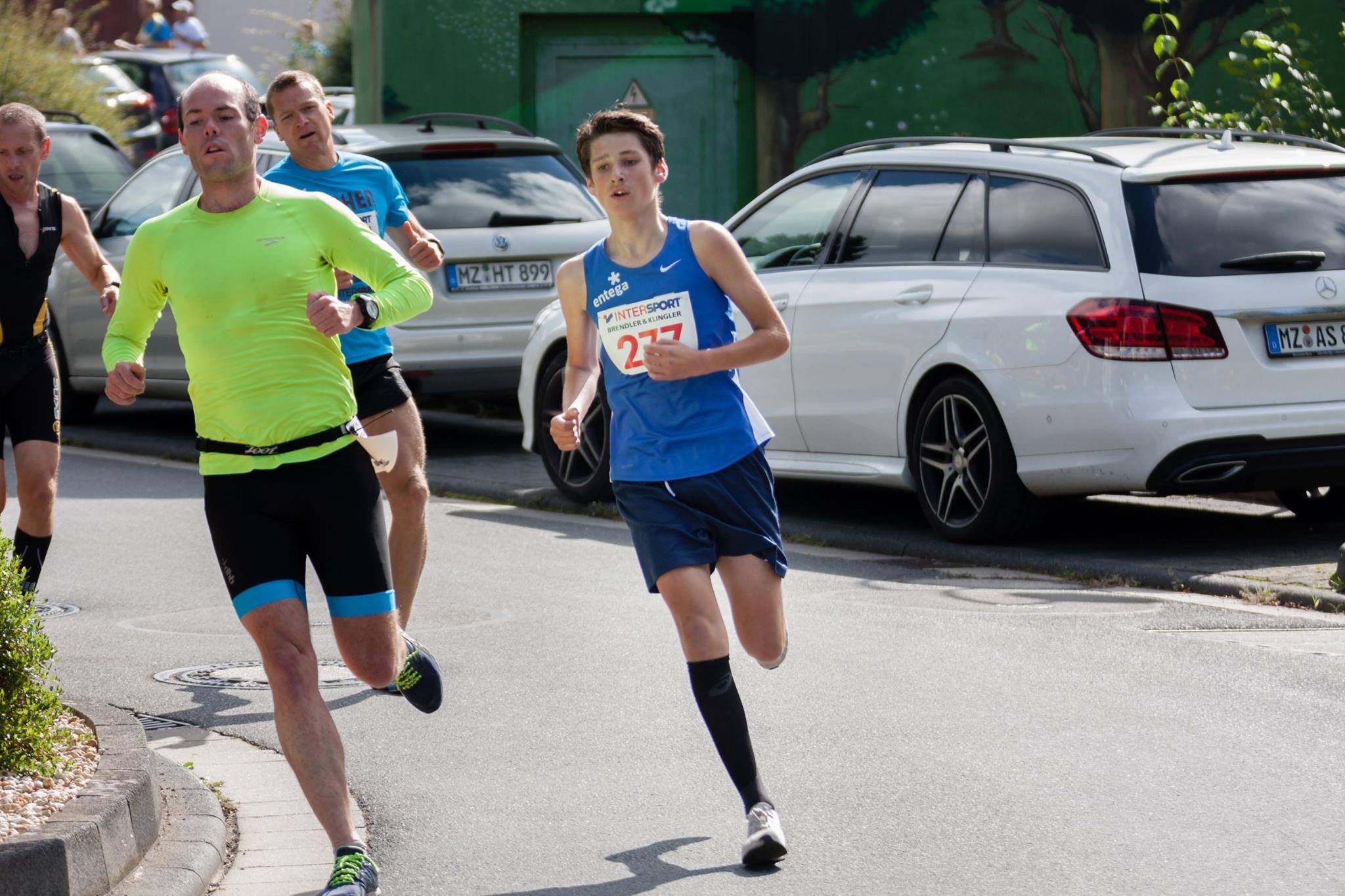 Kid running the 5k, pretty impressive